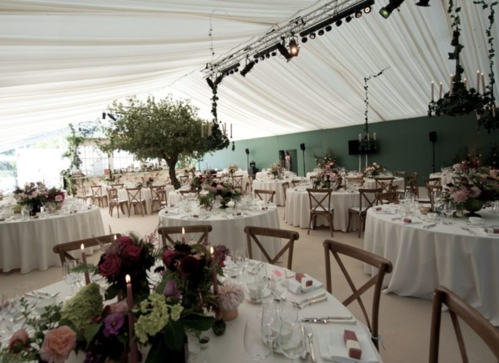 Flower Themed Wedding Marquee with Wooden Cross Backed Chairs