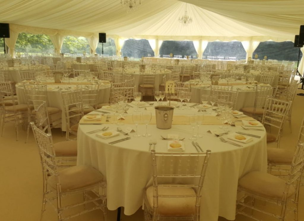 Ghost Chivari Chairs inside Wedding Marquee