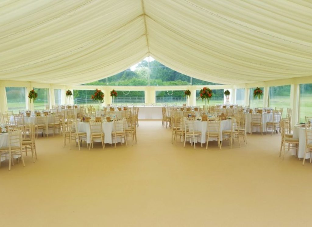 Wooden Chivali Chairs inside Wedding Marquee